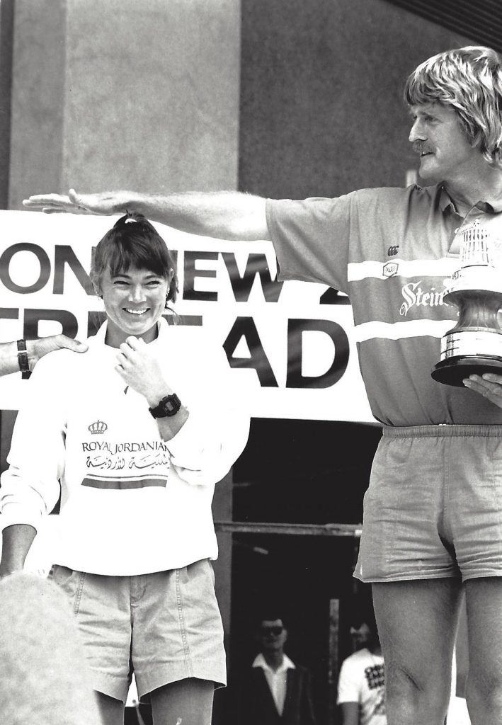 Sir Peter Blake holds his arm above Tracy's head, showing show short she is. Black and white photo from 1990
