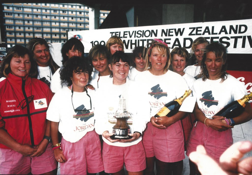 Tracy stands with the Maiden crew in 1990 holding the beefeater trophy