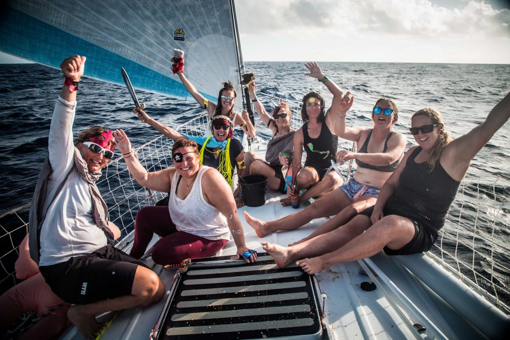 Crew onboard Maiden, smiling, laughing and waving after the equator crossing ceremony