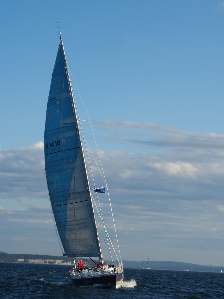 Maiden sailing with a blue sky behind