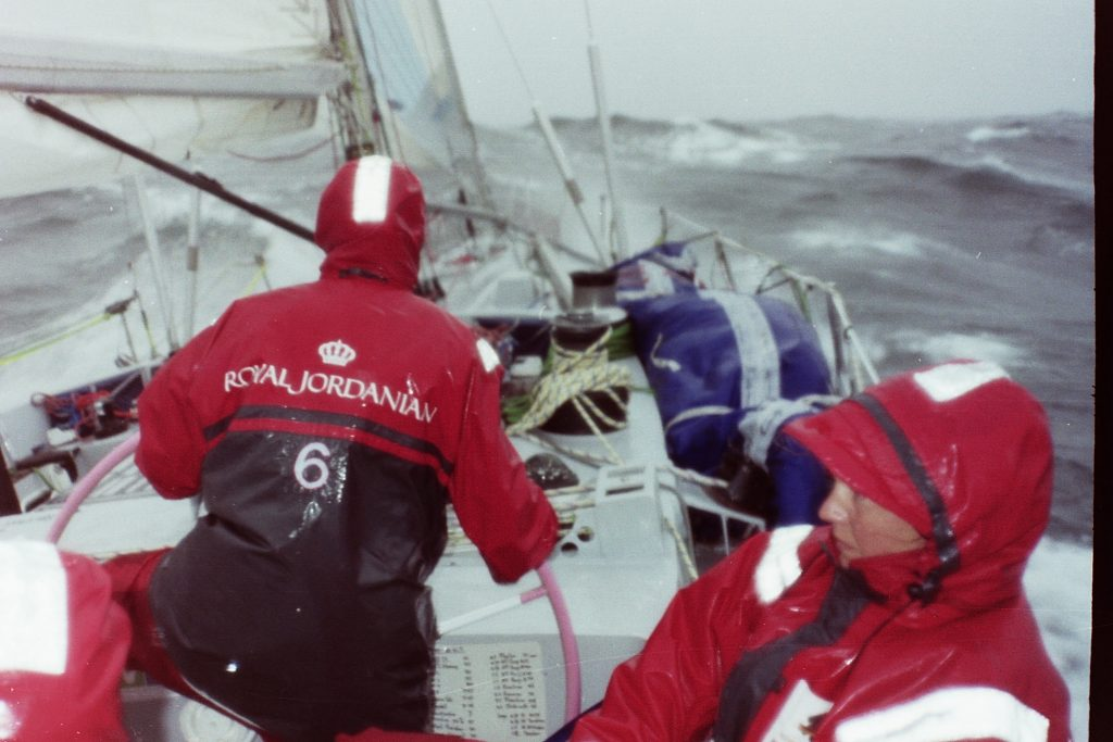 A wet southern ocean - two sailors onboard maiden in full foul weather gear, sodden
